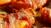 roast ham : Pumpkin slices baked in a bacon wrapping - macro closeup, sliding camera