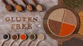 чечевица : Gluten free diet options - various seeds and grains in wooden spoons with writing in flour, stop motion animation Стоковые видеозаписи