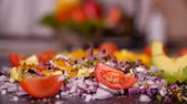 Adding sprouts to vegetables mix prepared on the cutting board - closeup, slow motion Vídeos
