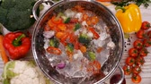 カリフラワー : Making a vegetable soup, ingredients falling into cooking pot filled with water - top view, slow motion