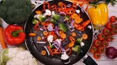couve flor : Making stir fried vegetables, ingredients falling into the frying pan - top view, slow motion Vídeos