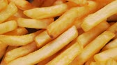 fast food : Delicious french fries extreme close up - camera slide, top down view Stock Footage