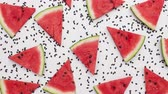 수박 : Watermelon slices swinging among melon seeds. Fruit background. Top view, stop motion animation.