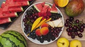 brzoskwinia : Summer fruits plate rotate and slowly empties. Top view, stop motion animation.