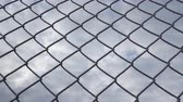 Hoarfrost on chain link metallic wire fence with cloudy skies background - camera slide 무비클립