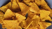 Tortilla chips filling a rotating rectangular plate - stop motion animation, close up