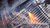 yards : Cutting metal sheet at the scrap yard with oxygen cutter, close up - waste management and recycling metals Stock Footage