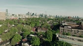söprés : Aerial footage of a modern city during the day. Cinematic 4K footage. Stock mozgókép