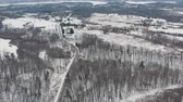ドロミテ : Aerial establishing shot of a curvy secluded road during the winter. Cinematic 4K footage.