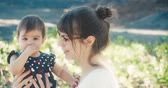 first child : Mother and Baby Girl Hugging and Laughing Outside on Vacation. 4K Cinematic footage. Stock Footage