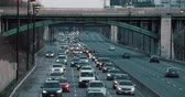 Telephoto shot of highway traffic. Shot on a cinema camera. 4K. Wideo