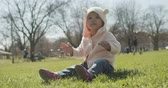 Adorable baby girl at the park dressed as a bear. Cinematic 4K footage. Stock Footage