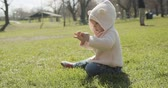 fofinho : Adorable baby girl at the park dressed as a bear. Cinematic 4K footage. Stock Footage