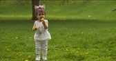 Adorable baby girl at the park dressed as a unicorn. Shot in 4K RAW on a cinema camera. Vídeos