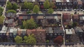 montáž : Aerial view of residential homes in late spring. Cinematic 4K establishing shot.