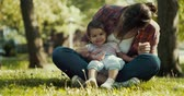 nórdico : Beautiful Mother and her baby daughter exploring the outdoors. 4K real life, candid footage. Stock Footage