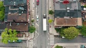 routes : 4K Establishing shot of a white transport truck as it travels into a city. Aerial tracking shot.