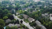 szomszédság : Aerial Establishing Shot of the Suburbs in Late Spring, Summer. Cinematic 4K Footage. Stock mozgókép