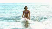 desportivo : Woman walking out of water in slow motion Stock Footage