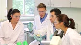 focalizada : Team of science students working in the lab at the university Stock Footage