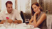 aborrecido : Woman being ignored on a date on slow motion Stock Footage