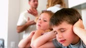 anger : Little siblings blocking out noise from parents fighting in slow motion