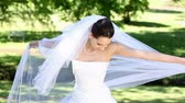 женат : Beautiful bride smiling at camera in the park on a sunny day