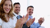 staff : Business people clapping in the office