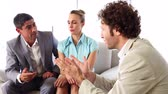 staff : Business people talking on sofa in the office Stock Footage