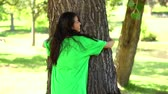 prato : Happy environmental activist hugging a tree on a sunny day Stock Footage