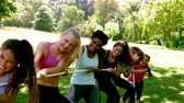 guerra : Group of fit women pulling a rope in slow motion
