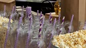 palack : on the buffet table there are bottles for juice with straws and popcorn