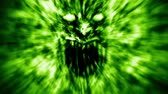 ухмыляясь : Angry demon face screams in fire. Animation in genre of horror. Green color.