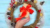 оладья : Christmas beautiful wreath on a wooden table, New Year decoration,