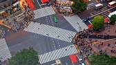 district : Time lapse of Shibuya pedestrian crossing also known as Shibuya scramble