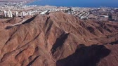 arab : Eilat, Israel - Aerial footage over Solomons mountains, revealing Eilats skyline and the red sea