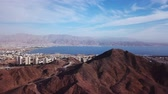 judaico : Eilat, Israel - Aerial footage over Solomons mountains, revealing Eilats skyline and the red sea