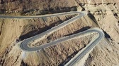 road top view : Desert road - Aerial footage of traffic going up and down a serpentine mountain road