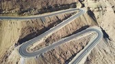 zigzag : Desert road - Aerial footage of traffic going up and down a  serpentine mountain road