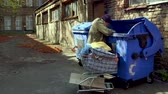 dakloze : Homeless man searching for empty bottles and other stuff for recycle.