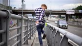 mladých dospělých : Sexy Man In Casual Clothes Walking On Bridge. Solo Walking Concept.