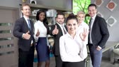 company : Business People Making Photo After Conference. Standing Middle Office. Young Woman With Ok Sign Standing Before.