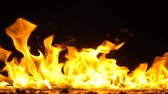 explodir : Golden Flames On Black Background Stock Footage