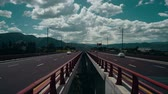 hauling : Truck traffic on a high bridge Stock Footage