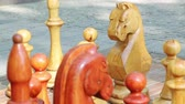 chess board : Focus shifting on big wooden chess figures Stock Footage