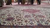 article : feet of blur people in iran antique carpet textile handmade beautiful arabic ornament