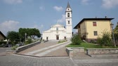 article : in italy Cadrezzate ancient building for religion catholic and clock tower