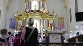 blossom : in philippines crowd of people in a wedding cerimony inside a antique catholic church Stock Footage