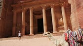 siq : people in the antique site of Petra in Jordan the beautiful wonder of the world