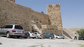 battlements : People in jordan the old castle of ash shubak and his tower in the sky Stock Footage